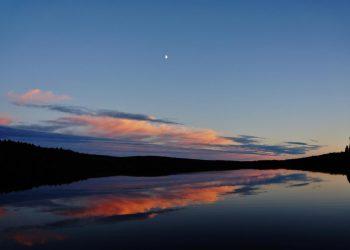 Moon over lake horizon