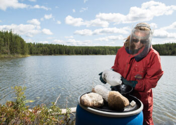 scientist at work on a lake