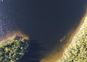 Drone shot of an island and lake shoreline